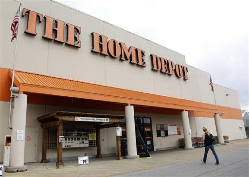 FILE - In a Tuesday, Aug. 14, 2012, file photo, aperson walks toward a Home Depot in Nashville, Tenn. Home Depot's fiscal fourth-quarter net income surged 32 percent, the home improvement retailer said Tuesday Feb. 26, 2013. (AP Photo/Mark Humphrey, File)