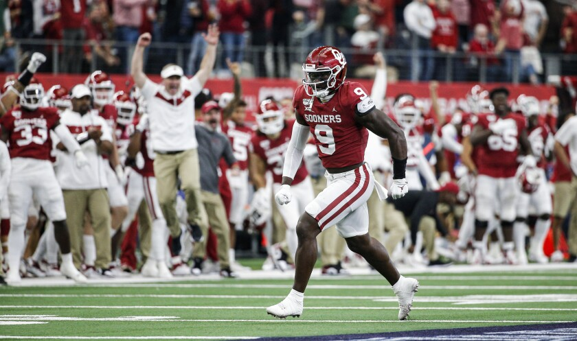 Oklahoma linebacker Kenneth Murray celebrates sacking Baylor quarterback Charlie Brewer during the Big 12 Championship.