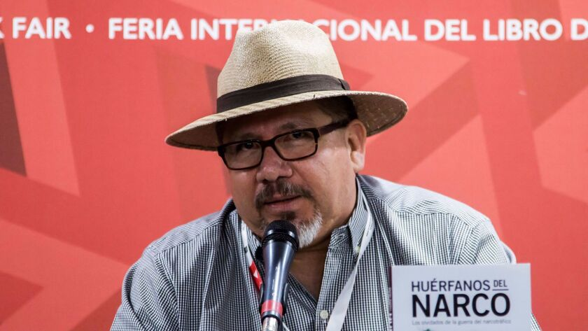 This file photo taken on November 27, 2016 shows Mexican journalist Javier Valdez speaking during th