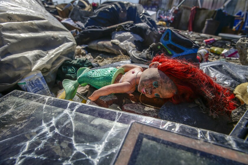 Piles of trash remain near 25th Street and Long Beach Avenue in Los Angeles.