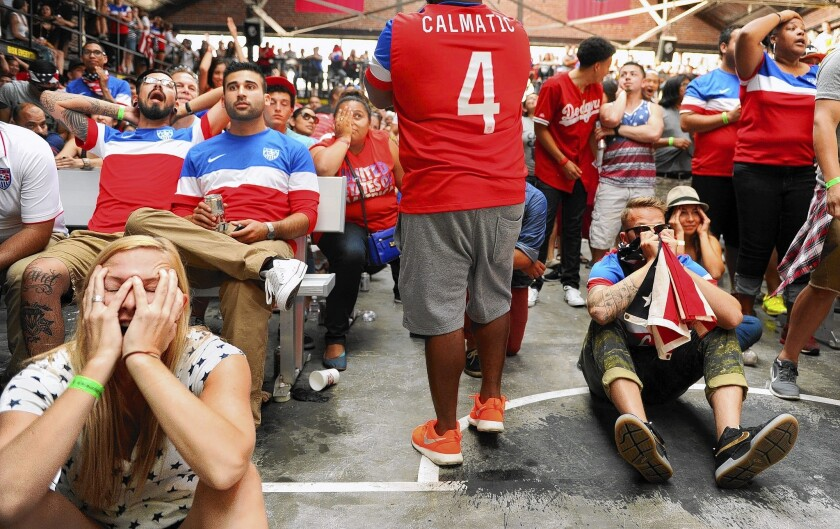 Fans at a World Cup viewing party in downtown L.A. can't bear to look after the U.S. gave up the tying goal against Portugal. There was a second viewing party at Lot 613 in the Arts District. The teams ended up in a 2-2 tie.