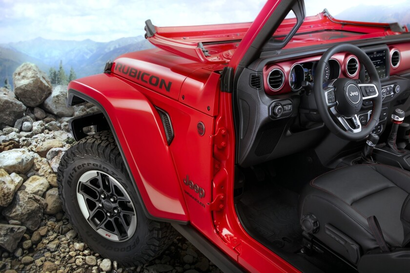The Wrangler's windshield still folds (with greater simplicity), the doors can still be removed and there's still a manual hand-brake lever on the shifter console.