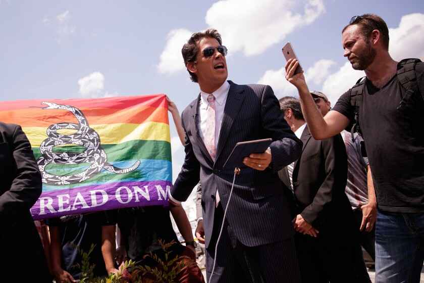 Conservative columnist and Internet personality Milo Yiannopoulos, center, has been permanently banned from Twitter.