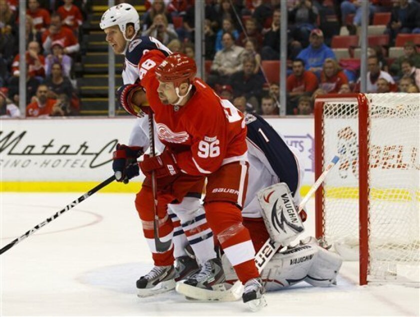 Detroit Red Wings left wing Tomas Holmstrom (96), of Sweden, and Columbus Blue Jackets defenseman Marc Methot, rear left, battle for position in front of goalie Steve Mason (1) in the third period of an NHL hockey game in Detroit, on Friday, Oct. 21, 2011. Detroit won 5-2. (AP Photo/Rick Osentoski)