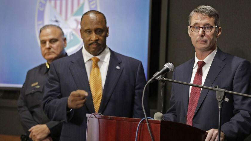Paul Delacourt, right, assistant director in charge of the FBI's Los Angeles office, takes questions after announcing the arrest of 10 Osage Legend Crips members. He is joined by Inglewood Police Chief Mark Fronterotta, left, and Mayor James T. Butts.