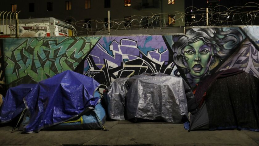 Tents line San Julian Street on skid row. A new data analysis suggests that about 100,000 people experienced homelessness in L.A. County at some point in 2017.