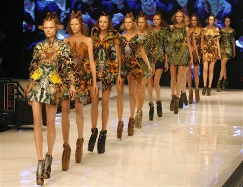 Models present creationby British fashion designer Alexander McQueen for his Ready to Wear Spring Summer 2010 fashion collection, presented in Paris, Tuesday Oct. 6, 2009. (AP Photo/Michel Euler)