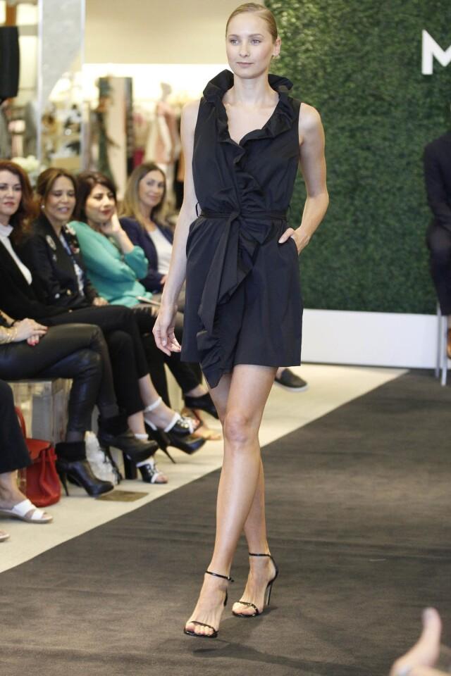 Milly Spring 2017 collection, Sleeveless Stretch-Poplin Ruffle-Front Wrap Dress, Black, $425.00. (John Gastaldo)