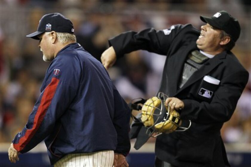 Home plate umpire Hunter Wendelstedt throws out Minnesota Twins manager Ron Gardenhire during the seventh inning of Game 2 of baseball's American League Division Series against the New York Yankees, Thursday, Oct. 7, 2010, in Minneapolis. (AP Photo/Charlie Neibergall)