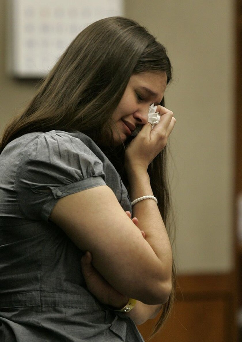 Brea Hansen, 19, cries after she is found guilty of first-degree murder as a jury announces the   verdict Thursday.