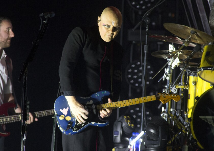 FILE - Billy Corgan of The Smashing Pumpkins performs in concert at the BB&T Pavilion in Camden, N.J., in this Aug. 8, 2019, file photo. Corgan is set to reboot the National Wrestling Alliance, founded in 1948 and the once proud stomping grounds of Ric Flair, Lou Thesz, Harley Race and other wrestling legends, injecting the company with a 21st century flavor.(Photo by Owen Sweeney/Invision/AP)