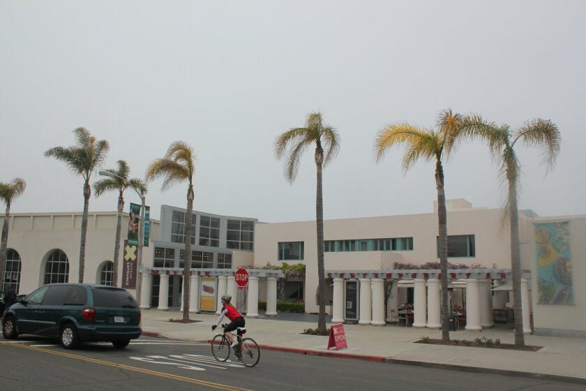 University of California Farm Advisor David Shaw said these palms in front of MCASD look like they have been poorly maintained. Although poisoning may be one cause, Shaw said he would not rule out: problems with irrigation, drainage or container size; improper fertilization; or changes to the root zone. Pink rot fungus could likely infect trees in this condition, he said. Pat Sherman