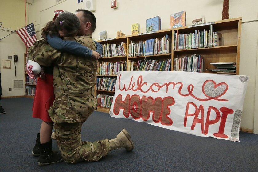A member of the U.S. California Army National Guard reunites with his daughter after being deployed for nearly a year. A new study finds that California children with a parent in the military were more likely than their peers to attempt suicide.