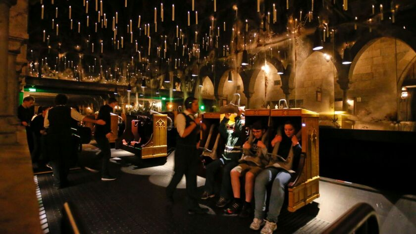 Candlesticks float above the riders on Harry Potter and the Forbidden Journey at Universal Studios Hollywood. The park, which had removed the 3-D feature on the ride, is adding high-definition images.
