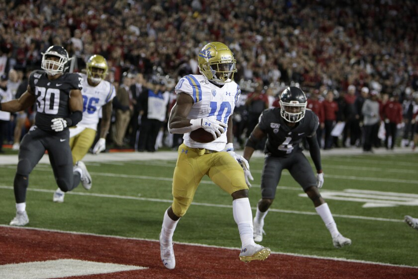 UCLA wide receiver Demetric Felton (10) scores the go-ahead touchdown during the second half Saturday night.