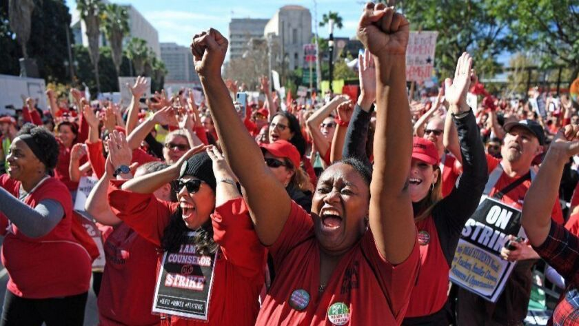 LAUSD teachers and their supporters celebrate after an announcement at City Hall on Tuesday that the district and UTLA had agreed on a contract.
