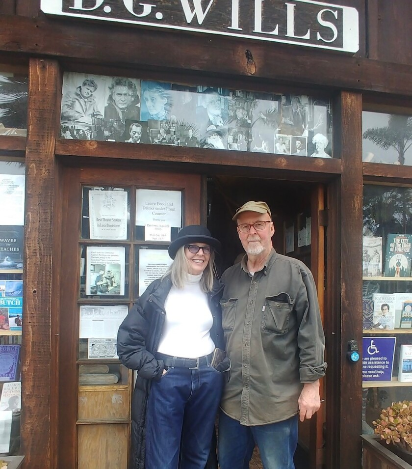 Actress Diane Keaton takes a break from browsing at D.G. Wills Books in La Jolla on June 29 to pose with owner Dennis Wills.