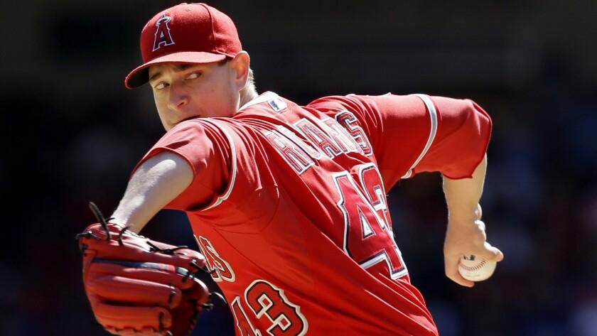Angels starter Garrett Richards pitches against the Texas Rangers in Arlington, Texas, on Oct. 4.