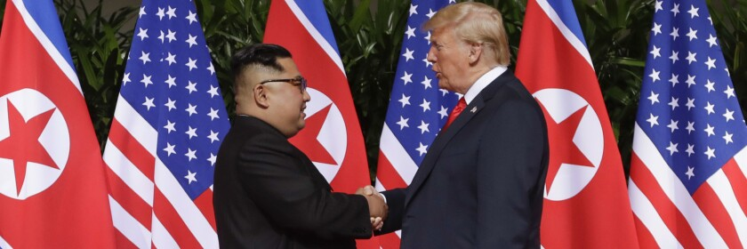 President Trump and North Korea's Kim Jong Un shake hands at their 2018 meeting in Singapore.