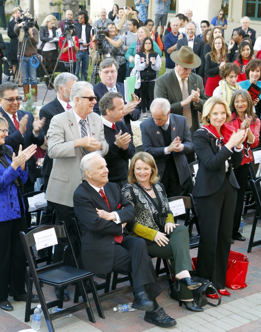 Conrad Prebys (left) (seated with partner Debbie Turner) receives a standing ovation from the crowd for his $20million donation to SDSU on Wednesday in San Diego, California.