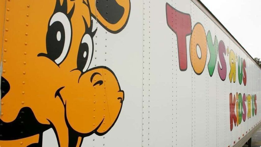 Geoffrey the Giraffe is seen on the side of a Toys R Us truck March 17, 2005, in Colma, Calif.