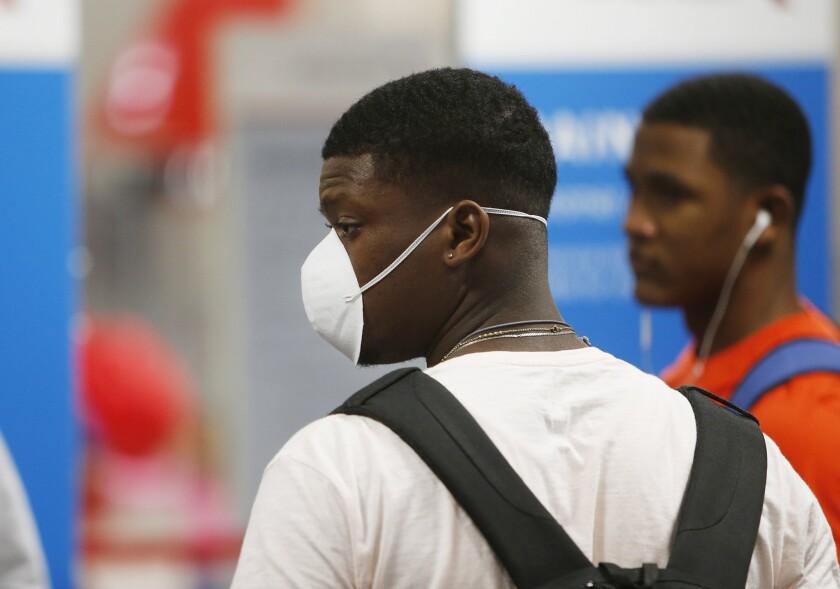 Blue Jays minor leaguer Luis De Los Santos wearing a face mask at Tampa International Airport.