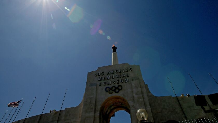 The Olympic torch burns atop the Los Angeles Memorial Coliseum after the city was officially awarded the rights to host the 2028 Olympic Games on Sept. 13, 2017.