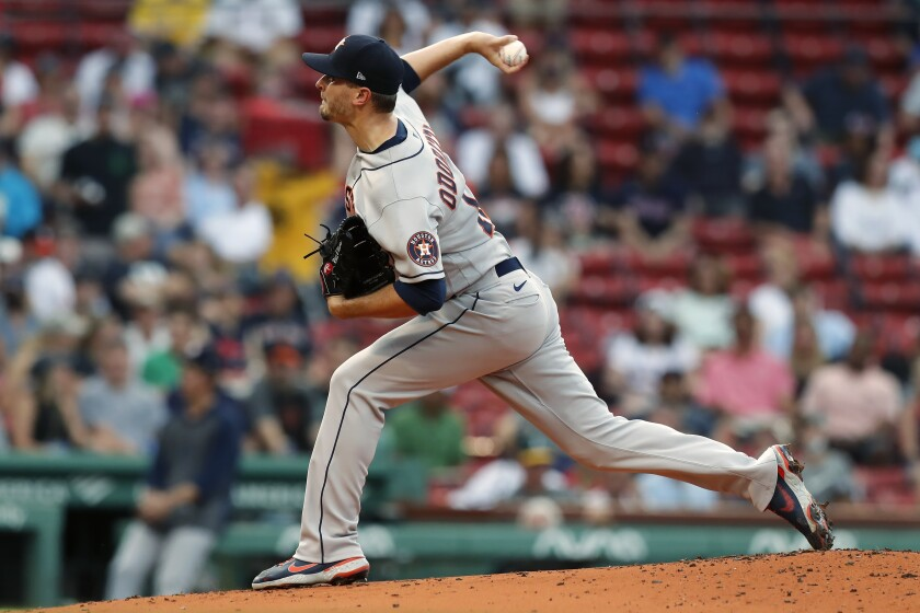 Houston Astros' Jake Odorizzi pitches during the first inning of a baseball game against the Boston Red Sox, Wednesday, June 9, 2021, in Boston. (AP Photo/Michael Dwyer)