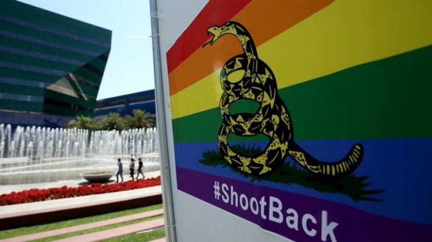 A poster featuring a rainbow-colored version of the Gadsden flag and the hashtag #ShootBack in front of the Pacific Design Center in West Hollywood.