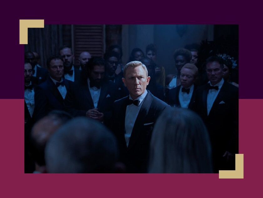 Daniel Craig as James Bond stands in a crowd in a scene from in 'No Time To Die.'