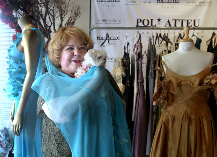 Emmy-nominated actress Patrika Darbo, with her dog SnowWhite, tries on a dress at Pol Atteu, Haute Couture, in Beverly Hills on Tuesday, Aug. 9, 2016.