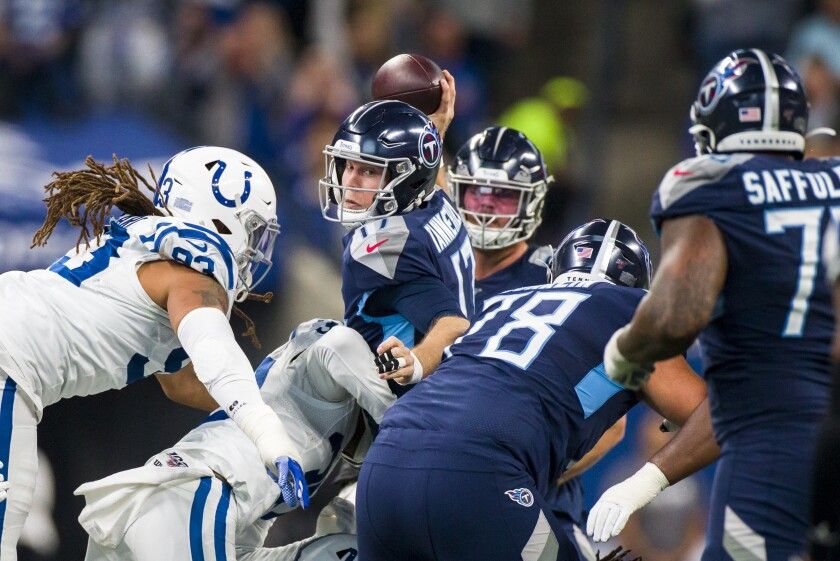 Tennessee Titans quarterback Ryan Tannehill looks to pass as he is sacked by Indianapolis Colts linebacker Anthony Walker.
