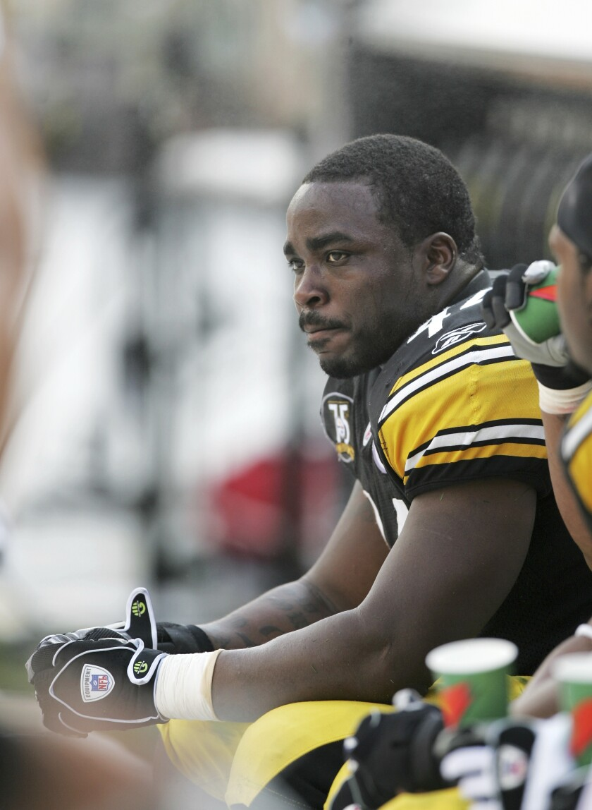 """FILE - Pittsburgh Steelers running back Najeh Davenport (44) sits on the bench during an NFL football game against the Seattle Seahawks in Pittsburgh, in this Sunday, Oct. 7, 2007, file photo. A federal judge on Monday, March 8, 2021, dismissed a lawsuit that challenged """"race-norming"""" in dementia tests for retired NFL players, a practice that some say makes it harder for Black athletes to show injury and qualify for awards. Davenport was denied an award but would have qualified had they been white, according to their lawsuit. (AP Photo/Keith Srakocic, File)"""