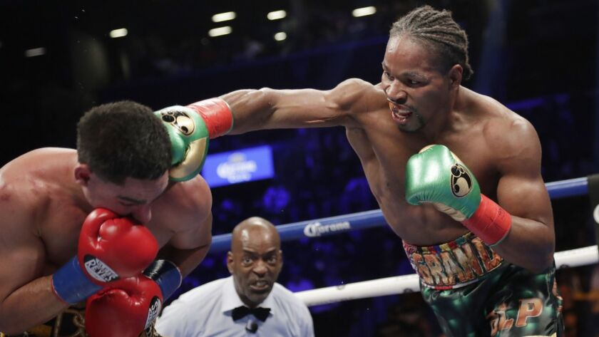 Shawn Porter, right, punches Danny Garcia during the eighth round.