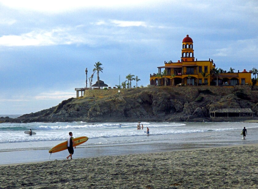 Surfers and swimmers share Cerritos Beach, just south of Todos Santos and among the most swimmable along the Baja coast. The Hacienda Cerritos hotel is in the background.