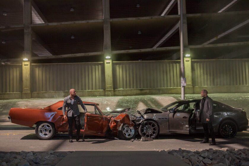 """Vin Diesel, left, plays Dom Toretto and Jason Statham plays Deckard Shaw in a scene from """"Furious 7."""" The Universal Pictures film was No. 1 for the fourth consecutive weekend at the box office, earning $18.3 million. Its total domestic haul is $320.5 million."""