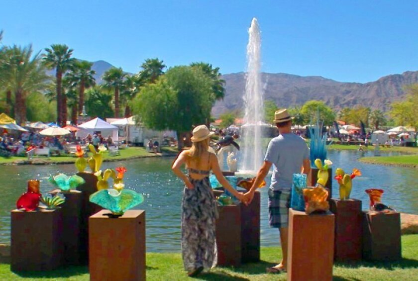 A couple surveys the festival scene during the 2014 La Quinta Arts Festival.