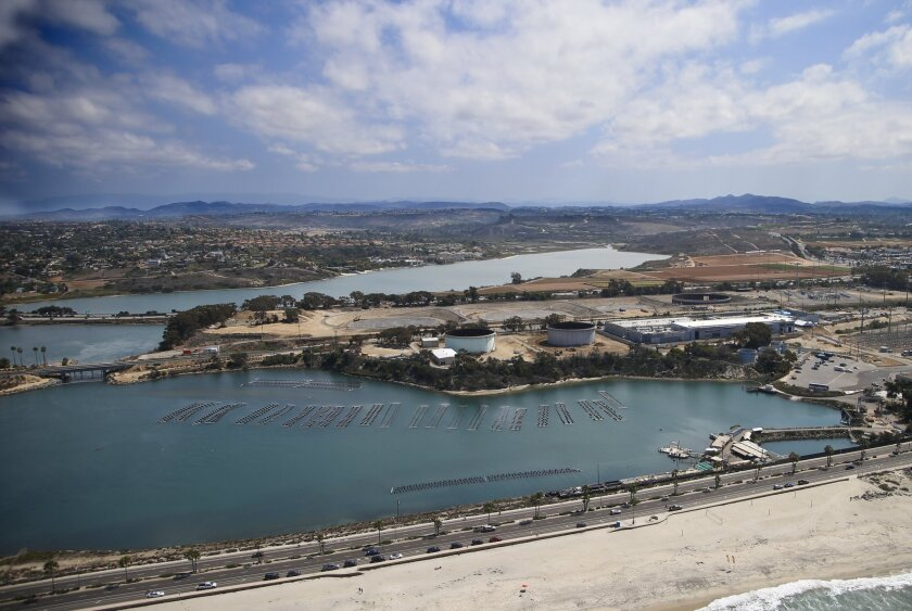 Much of San Diego County could benefit from the proposed easing of water-conservation rules because of a desalination plant in Carlsbad, shown above in September.