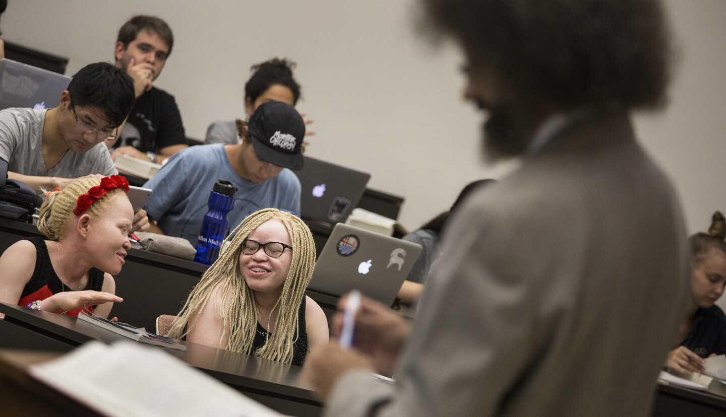 Tindi, left, and Bibiana Mashamba, albino sisters from Tanzania, sit in on professor Jody Armour's USC tort law class on Aug. 24. They just received asylum in the U.S.