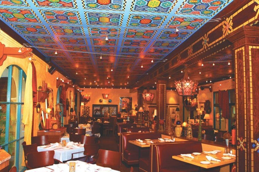 The Prado's main dining room is filled with hand-crafted decor, Latin architecture, Spanish ceiling tiles; and glowing, romantic lighting in the evening.