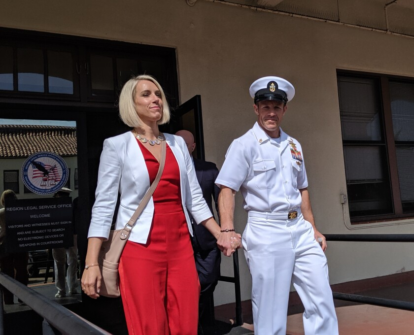 Chief Special Warfare Operator Edward R. Gallagher, right, and his wife, Andrea Gallagher, leave the courthouse at Naval Base San Diego Friday after a motions hearing in his ongoing war crimes court-martial.