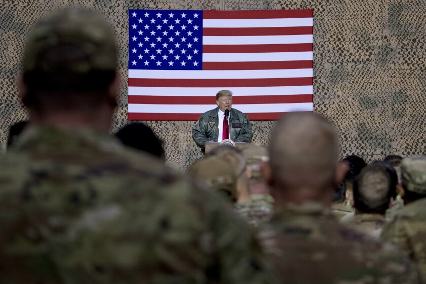 FILE - In this Dec. 26, 2018, file photo, President Donald Trump speaks to members of the military in Iraq.