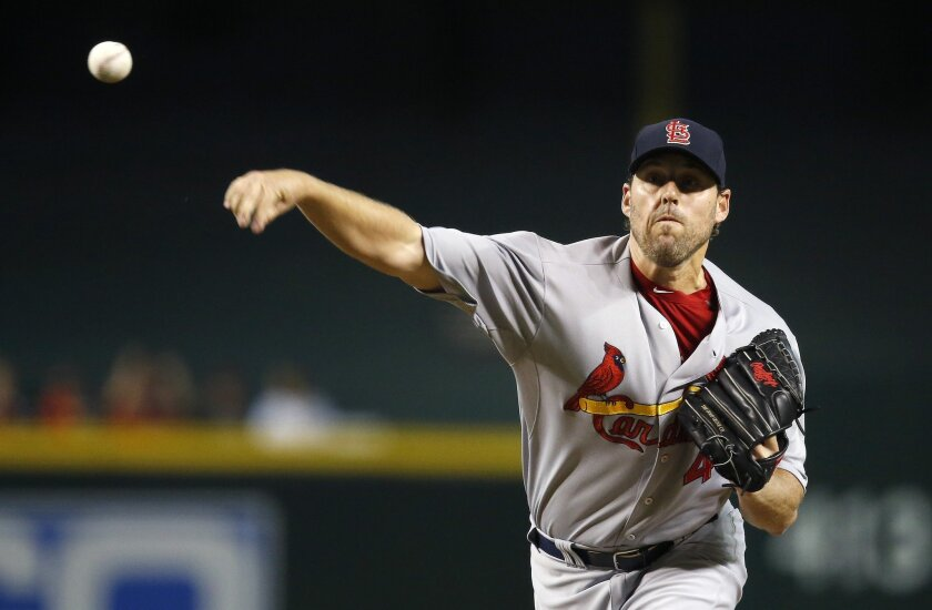 St. Louis Cardinals' John Lackey throws a pitch against the Arizona Diamondbacks during the first inning of a baseball game Wednesday, Aug. 26, 2015, in Phoenix. (AP Photo/Ross D. Franklin)