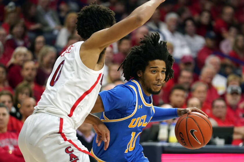 UCLA guard Tyger Campbell drives during the Bruins' 65-52 victory at No. 23 Arizona on Feb. 8, 2020.