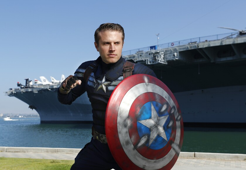Matt Mullis dressed in Captain America's Stealth Suit, from The Winter Soldier near the USS Midway Museum in San Diego.