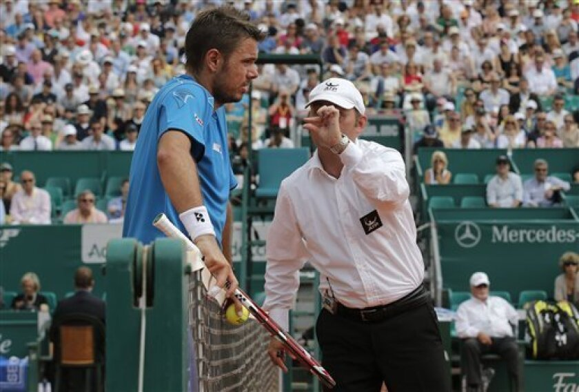 Stanislas Wawrinka of Switzerland speaks with the referee during his quarter final match of the Monte Carlo Tennis Masters tournament in Monaco against France's Jo-Wilfried Tsonga, Friday, April 19, 2013. (AP Photo/Lionel Cironneau)