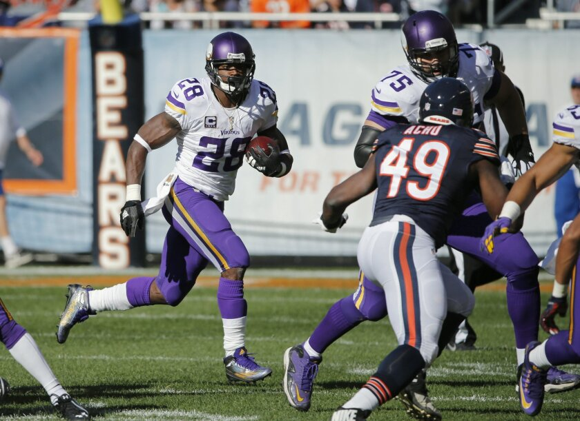 Minnesota Vikings running back Adrian Peterson (28) rushes during the first half of an NFL football game against the Chicago Bears, Sunday, Nov. 1, 2015, in Chicago. (AP Photo/Charles Rex Arbogast)