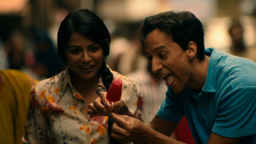 "Ruby (Karen David) and Sami (Danny Pudi) in ""The Tiger Hunter."""