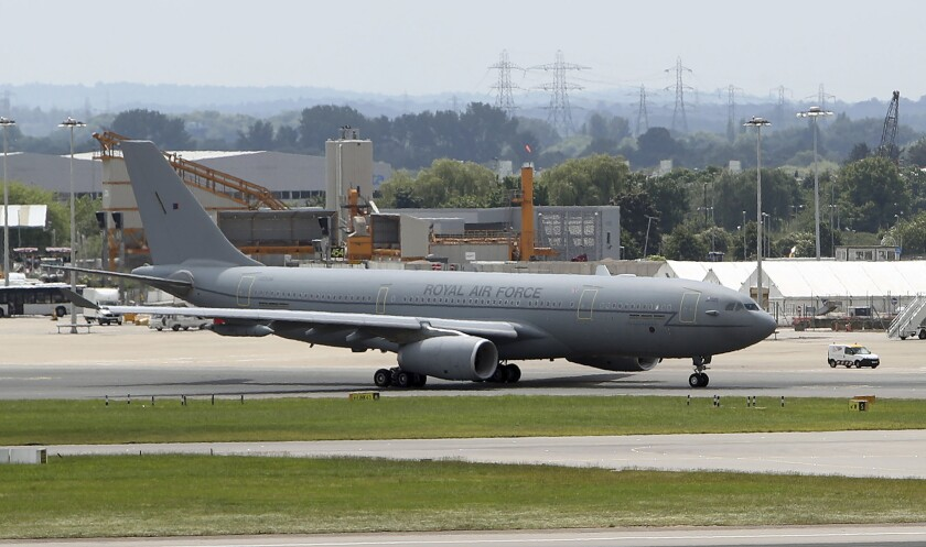 """FILE - In this file photo dated July 25, 2017, an RAF Voyager used by the Prime Minister and members of the royal family which is to be repainted in the colours of the Union flag. Johnson's spokesman, James Slack, said Wednesday June 17, 2020, that the grey RAF Voyager was being painted in the British union flag colours to """"better represent the U.K. around the world with national branding."""" (Steve Parsons/PA FILE via AP)"""