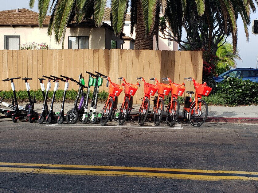 A scooter corral in north Pacific Beach includes Bird and Lime scooters, and Jump bikes. Jump's parent company, Uber, announced it would be removing its bikes and scooters from San Diego.